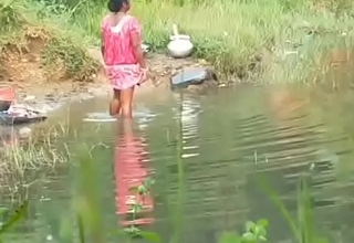 Aunty bathing outdoors
