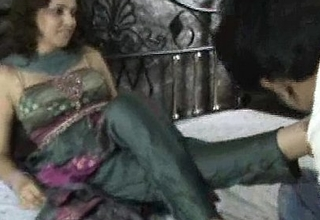 Indian wench in churidar foot worship