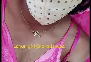 Indian crossdresser model Lara D'Souza in pink satin nighty