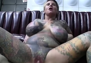 Full body tattooed milf with vagina piercing bonks in front of make an liaison of video camera