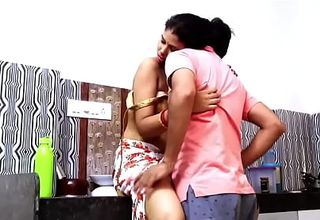 Indian coupling romance in kitchen