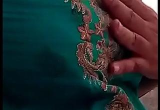 Young desi Indian Bhabhi showcasing her busty boobs