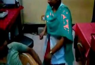 technician finguring lady nurse in convalescent home