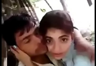 Desi Hindi speaking Indian couple giving a kiss