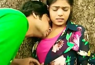 Sweet kissing Indian college sweeping outdoor romance